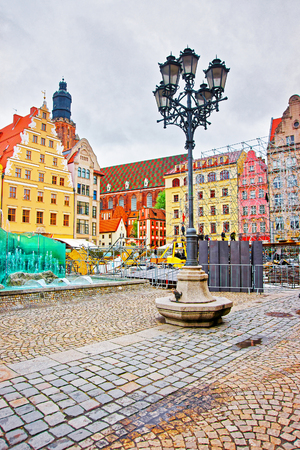 Fountain at the Market Square of Wroclaw, Poland. Tower of St Elizabeth Tower on the background Stock Photo
