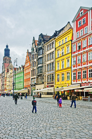 Wroclaw, Poland - May 3, 2014: People at the Market Square of Wroclaw in Poland. Tower of St Elizabeth Church on the background