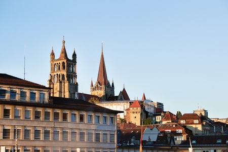 Lausanne Cathedral of Notre Dame in Lausanne city center, Switzerland. Seen from Le Flon district