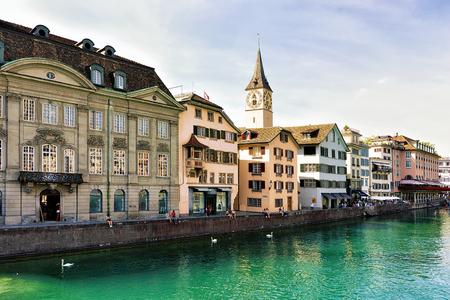 Zurich, Switzerland - September 2, 2016: Saint Peter Church at Limmat River quay in the city center of Zurich, Switzerland