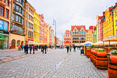Wroclaw, Poland - May 3, 2014: People at the Market Square in the old city center of Wroclaw, Poland.