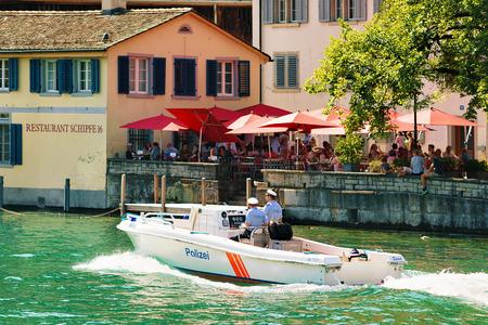 Zurich, Switzerland - September 2, 2016: Police motor boat at Limmat River in Zurich, Switzerland