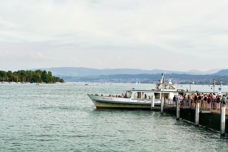 Zurich, Switzerland - September 2, 2016: People loading into ferry at Pier in Zurich Lake, Switzerland Editorial
