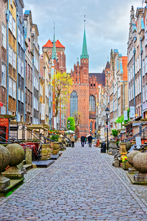 Gdansk, Poland - May 7, 2014: Street and Fragment of St Mary Basilica in the old city center in Gdansk, Poland. People on the background Redakční