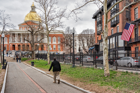 Boston, USA - April 28, 2015: Man at State Library of Massachusetts at Boston Common public park in downtown Boston, MA, United States. People on the background Editorial