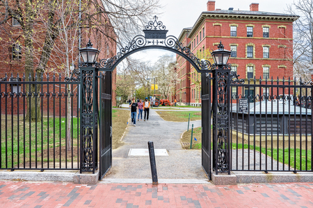 Cambridge, USA - April 29, 2015: Entrance gate into Harvard Yard in Harvard University of Cambridge, Massachusetts, MA, USA. People on the background