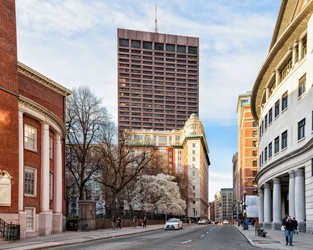 Boston, USA - April 29, 2015: Skyscrapers in Tremont Street in downtown Boston, MA, US. People on the background