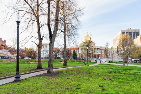 Boston, USA - April 29, 2015: State Library of Massachusetts and people in Boston Common public park in downtown Boston, MA, United States. People on the background