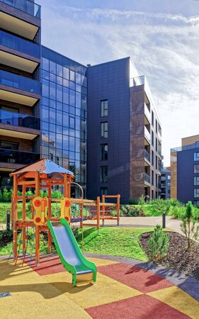 Children playground at Modern complex of apartment residential buildings. And outdoor facilities.