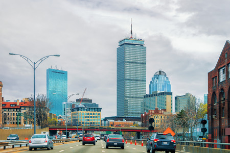 Skyscrapers and the road with car traffic in Boston, MA, USA.
