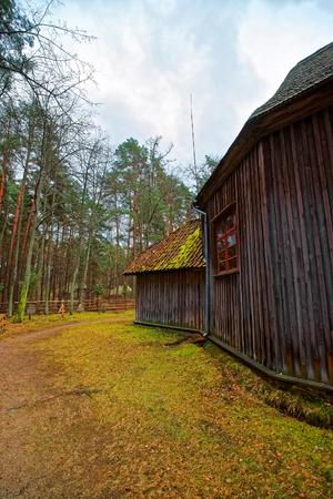 Riga, Latvia - December 27, 2011: Old wooden building in Ethnographic open air village, Riga, Latvia