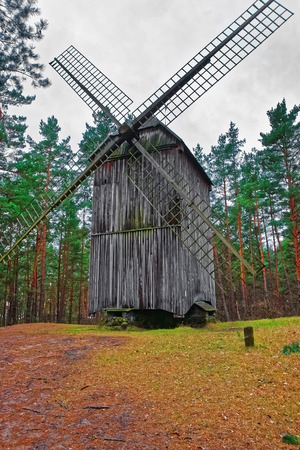 Riga, Latvia - December 27, 2011: Old wooden windmill in Ethnographic open air village, Riga, Latvia
