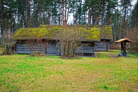 ethnographical: Riga, Latvia - December 27, 2011: Old wooden house at Ethnographic open air village of Riga, Latvia