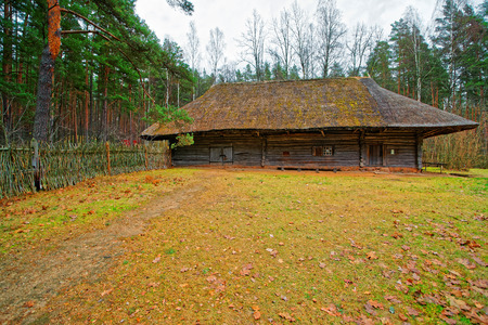 ethnographical: Riga, Latvia - December 27, 2011: Old wooden house in Ethnographic open air village in Riga, Latvia