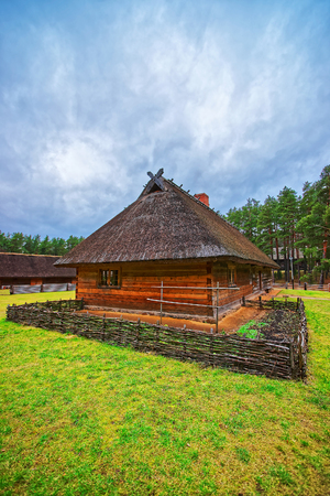 ethnographical: Riga, Latvia - December 27, 2011: Old wooden building at Ethnographic open air village in Riga, Latvia