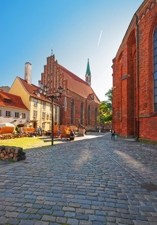 Riga, Latvia - September 3, 2014: People at St John Church in the historical center of the old town in Riga, Latvia.