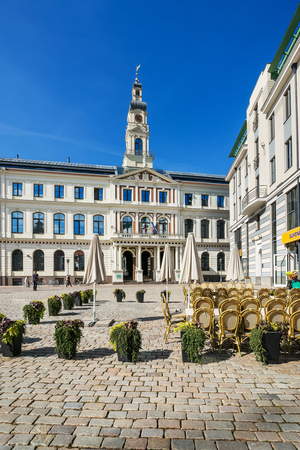 Riga, Latvia - September 3, 2014: City Council at the Town Hall square in the historical center in the old town, Riga, Latvia. People on the background Editorial
