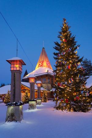 rovaniemi: Rovaniemi, Finland - March 5, 2017: Street lanterns on Arctic Circle at Santa Claus Village with Christmas trees, Lapland, Finland, in winter. Editorial