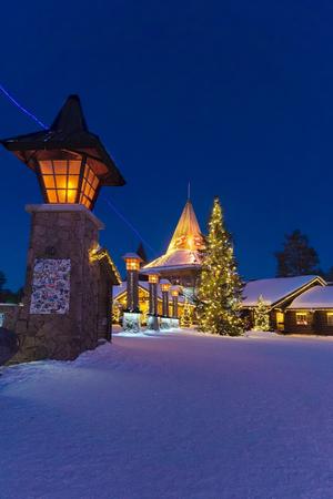 rovaniemi: Rovaniemi, Finland - March 5, 2017: Street lanterns on Arctic Circle in Santa Claus Village with Christmas trees, Lapland, Finland, in winter. Stock Photo