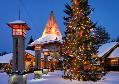 Rovaniemi, Finland - March 5, 2017: Santa Claus Office in Santa Village with Christmas trees at night illuminated with light, Lapland, Finland, on Arctic Circle in winter.