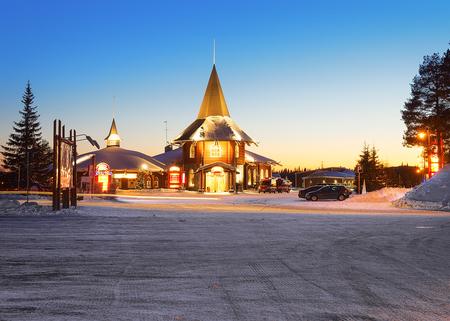 rovaniemi: Rovaniemi, Finland - March 5, 2017: Santa Claus Holiday Village, Lapland, Finland, in winter. At dusk Editorial