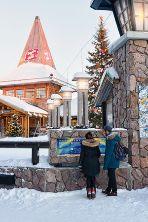 rovaniemi: Rovaniemi, Finland - March 5, 2017: Couple in Santa Claus Village, Lapland, Finland, on Arctic Circle in winter.