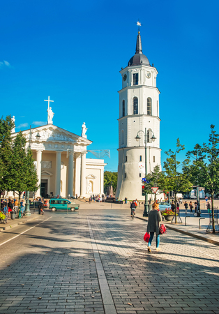 Vilnius, Lithuania - September 4, 2014: People on Gediminas Avenue at Cathedral square and belfry in the historical center of old town in Vilnius, Lithuania. Editorial