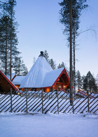 rovaniemi: Santa Claus Village at sunset, in Lapland, Finland, on Arctic Circle in winter. Editorial