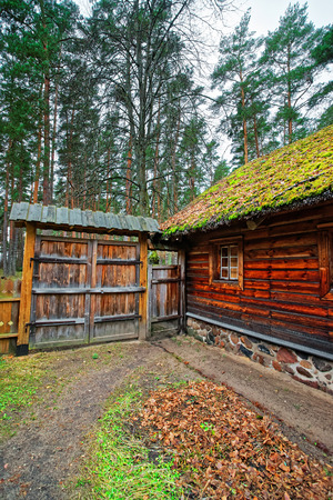 ethnographical: Old house and wooden fence at Ethnographic open air village in Riga, Latvia