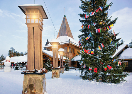 Santa Claus Office with Snowman in Santa Village with Christmas trees, Lapland, Finland, on Arctic Circle in winter.