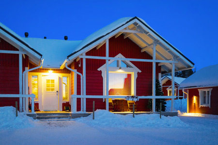 rovaniemi: Santa Claus Holiday Village Houses, Lapland, Finland, on Arctic Circle in winter. After sunset