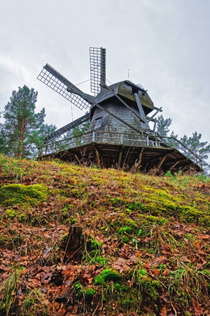 Old wooden windmill in Ethnographic open air village in Riga, Latvia