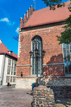 Facade of St John Church in the historical center of the old town of Riga, Latvia