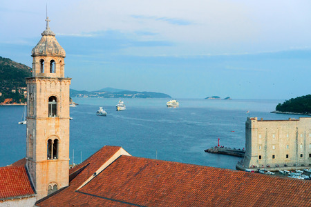 Old church bell tower and Adriatic Sea in Dubrovnik late in the evening, Croatia