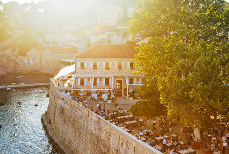 Dubrovnik, Croatia - August 19, 2016: People at Open Street terraced bar in Dubrovnik, of Croatia. View from the defensive city walls. At sunset Editorial