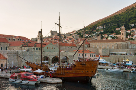 Dubrovnik, Croatia - August 19, 2016: Ship at the Old port in the Adriatic Sea in Dubrovnik, Croatia. People on the background Editorial
