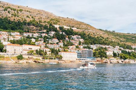 croatian: Dubrovnik, Croatia - August 19, 2016: Water Ferry with people at Dubrovnik coast in the Adriatic Sea, Croatia