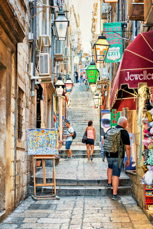 street lamp: Dubrovnik, Croatia - August 18, 2016: People at tight street with steps in the Old town of Dubrovnik, Croatia