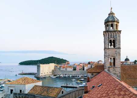 ragusa: Dominican monastery church belfry and Adriatic Sea, Dubrovnik late in the evening, in Croatia Stock Photo