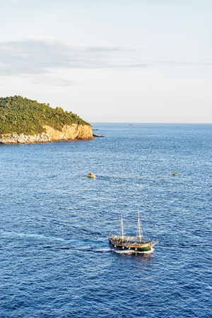 Ship at Lokrum Island in the Adriatic Sea in Dubrovnik, Croatia Stock Photo