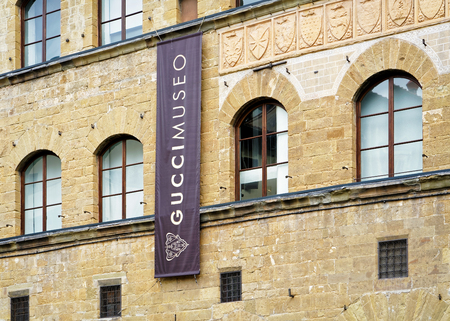 Florence, Italy - October 17, 2016: Gucci Museo Sign on street shop window, Florence, Italy.