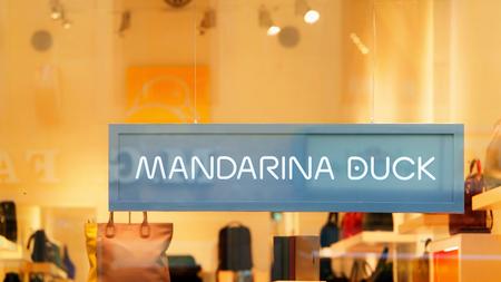 mandarina: Florence, Italy - October 16, 2016: Mandarina Duck Sign of street shop window in Florence.