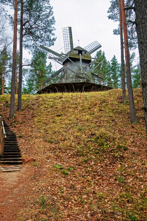Riga, Latvia - December 27, 2011: Wooden windmill in Ethnographic open air village of Riga, Latvia, Baltic country