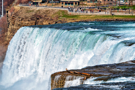 Niagara Falls, USA - April 30, 2015: Niagara Falls in America. A view on American Falls and Bridal Veil Falls. In early spring