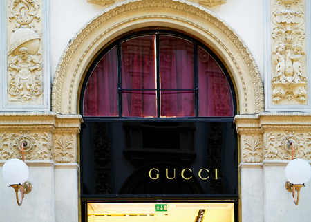 Milan, Italy - October 24, 2016: Gucci Sign on street shop window in Milan.