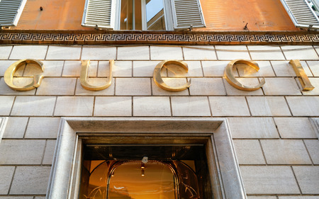 Rome, Italy - October 14, 2016: Gucci Sign on street shop window in Rome, Italy.