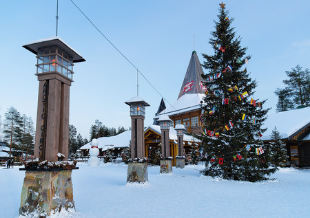 street lamp: Rovaniemi, Finland - March 6, 2017: Lanterns at Santa Claus Office in Santa Village with Christmas trees in Lapland, Finland, Scandinavia, on Arctic Circle in winter. Editorial