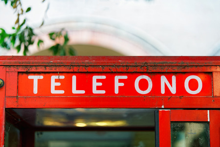 Fragment of red telephone box in Bologna, Italy Stock Photo