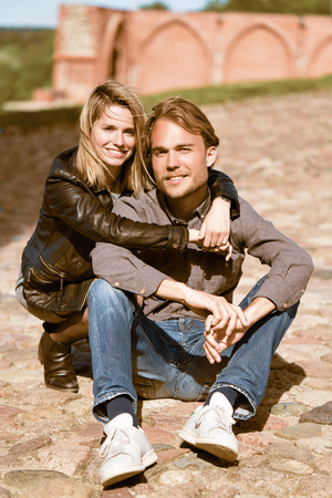 Young caucasian couple sitting as romantic concept Stock Photo