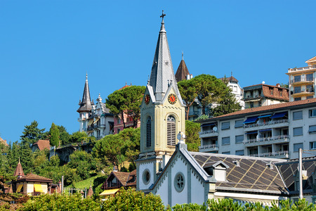 montreux: Church clock tower at Geneva Lake in Montreux, Swiss Riviera Stock Photo